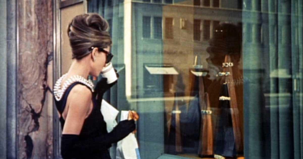Audrey Hepburn wears a pearl necklace in Breakfast at Tiffany's