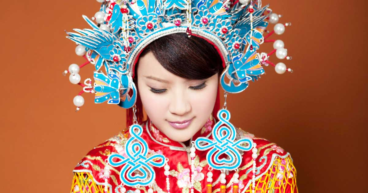 A woman wearing traditional Chinese wedding jewelry, including a headdress.