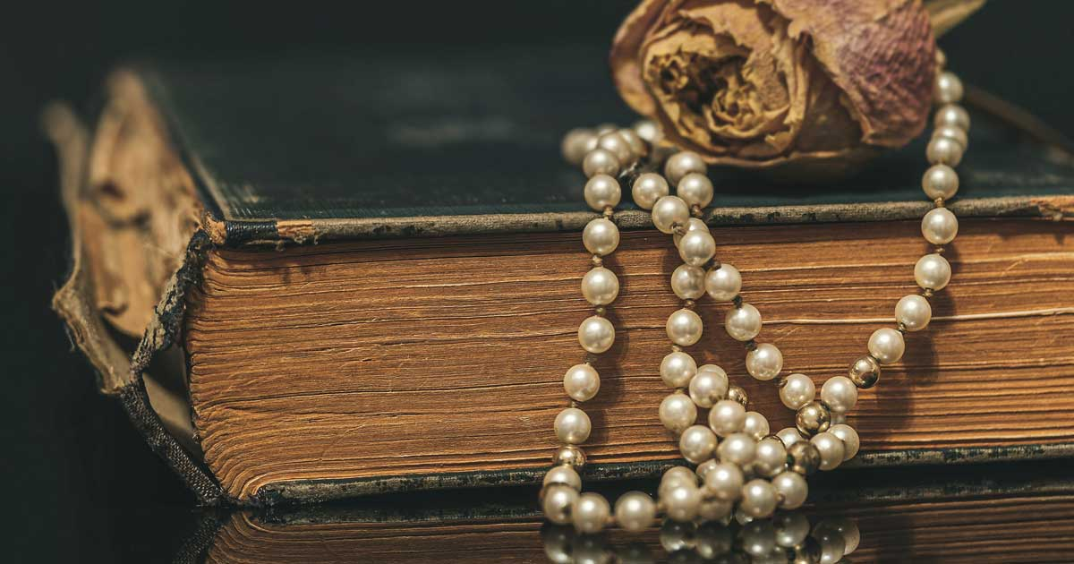 Classic literature and the timeless elegance of a cultured pearl necklace complement each other naturally.