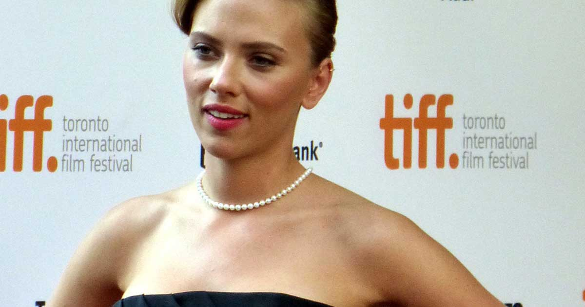 Scarlett Johansson wearing a simple strand of pearls.