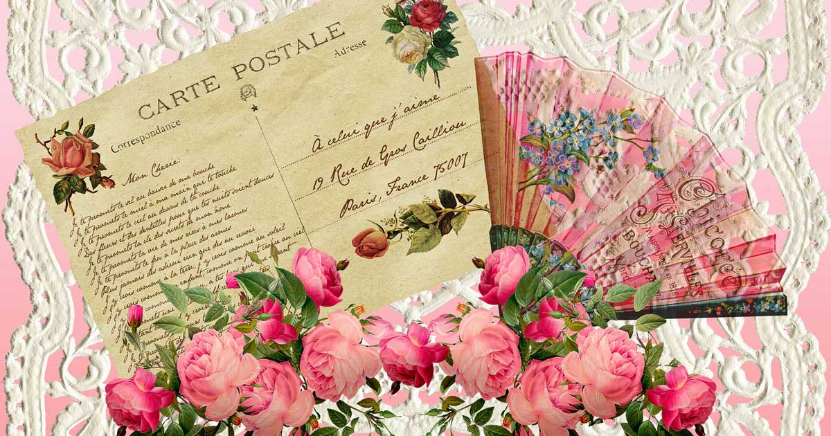 A card from the Victorian era with flowers and a fan