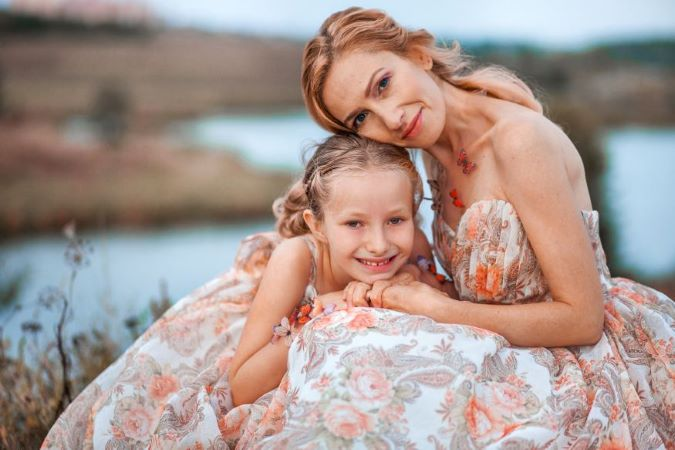 pretty mother and daughter wearing matching summer dresses