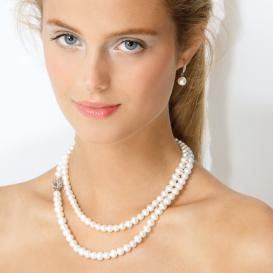 long strand of pearls doubled and clasped on the side