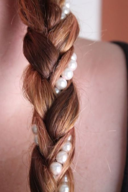 a strand of pearls can be woven through a braid or worn as a headband as an alternative use of pearls.