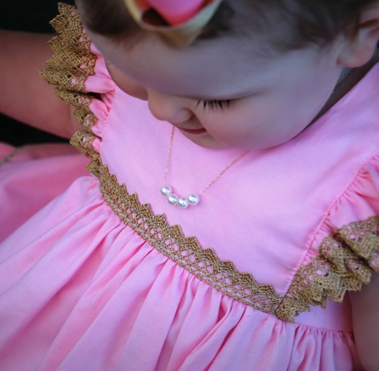 pearls on baby girl