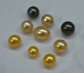 Gold and black cultured pearls