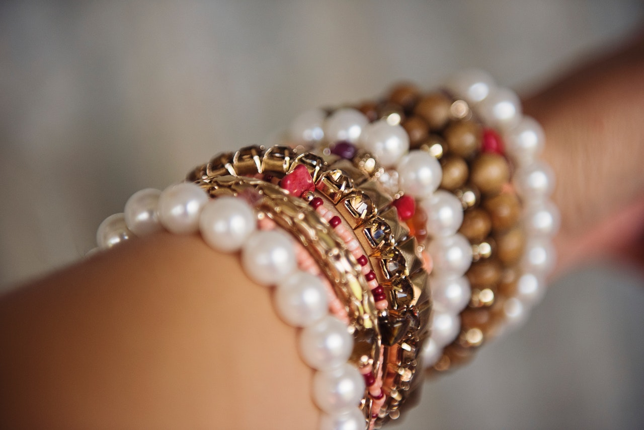 curated arm stack includes pearls, colorful beads and other metals.